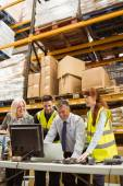 Warehouse team working together on laptop — Stock Photo