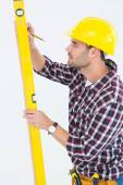 Technician marking while using spirit level — Stock Photo