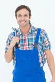Confident plumber holding tool — Stock Photo