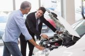 Two men looking at a car engine — Stock Photo