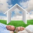 Mature couple lying against green field — Stock Photo #68906877