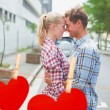 Couple in check shirts and denim hugging — Stockfoto #68907081