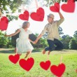 Couple jumping in the park — Stock Photo #68907647