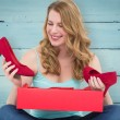 Woman discovering shoes in a gift box — Stock Photo #68907709