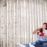 Couple having tea on floor — Stock Photo #68908655