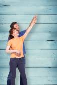 Couple pointing upwards together — Stock Photo