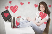 Pretty redhead with feet up on desk — Stock Photo