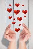 Hands presenting hearts — Stock Photo
