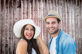 Happy hipster couple smiling at camera — Stock Photo