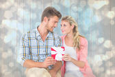 Couple with gift against light glowing dots — Stock Photo