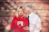 Man giving his wife a kiss on cheek — Stock Photo