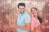 Happy couple sending text messages — Stock Photo