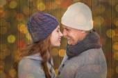 Couple in warm clothing facing each other — Stock Photo