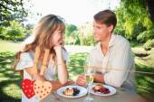 Couple having champagne and desert in the park — Stock Photo