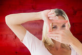Happy blonde framing with her hands — Stock Photo
