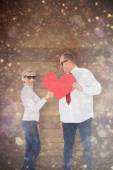Affectionate couple holding heart shape — Stock Photo