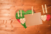 Hearts and card hanging on line — Stock Photo
