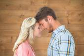 Attractive couple standing touching heads — Stock Photo