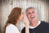 Woman telling secret to her partner — Stock Photo
