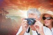 Vacationing couple taking photo — Stock Photo
