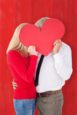 Man getting a heart card form wife — Stock Photo
