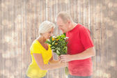 Man offering his partner flowers — Stock Photo