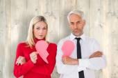 Couple not holding two halves of broken heart — Stock Photo