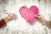 Couple holding a heart — Stock Photo