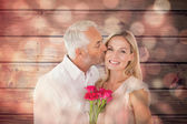 Affectionate man kissing his wife on the cheek — Stock Photo