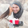 Winter couple holding gift — Stock Photo #68910525