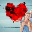 Couple hugging and holding paint roller — Stock Photo #68911421