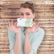 Woman showing an one hundred euro note — Stock Photo #68913741