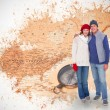 Couple in warm clothing against world map — Stock Photo #68914305