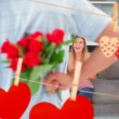 Man hiding  roses from smiling girlfriend — Stock Photo #68914507