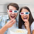 Young couple watching a 3d movie — Stock Photo #68914573