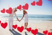 Couple forming heart shape with arms — Stock Photo