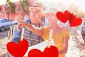 Tourist couple using map in the city — Stock Photo