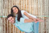 Man giving pretty girlfriend piggy back — Stock Photo