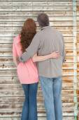 Casual couple standing arms around — Stock Photo