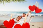 Couple napping in a hammock against hearts — Stock Photo