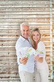Happy couple flashing their cash — Stock Photo