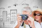 Vacationing couple taking photo — Stock Photo