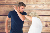 Angry man about to hit his girlfriend — Stock Photo