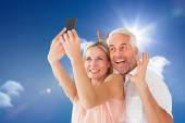 Couple posing for a selfie against blue sky — Stock Photo