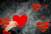 Hand with heart against hearts — Stock Photo