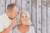 Man silencing his fearful partner — Stock Photo