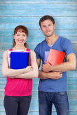 Two students both with notepads — Stock Photo