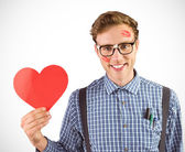 Geeky hipster holding a heart card — Stock Photo