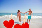 Man holding his girlfriends hand against hearts — Stock Photo