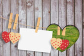 Hearts and card hanging on the line — Stock Photo